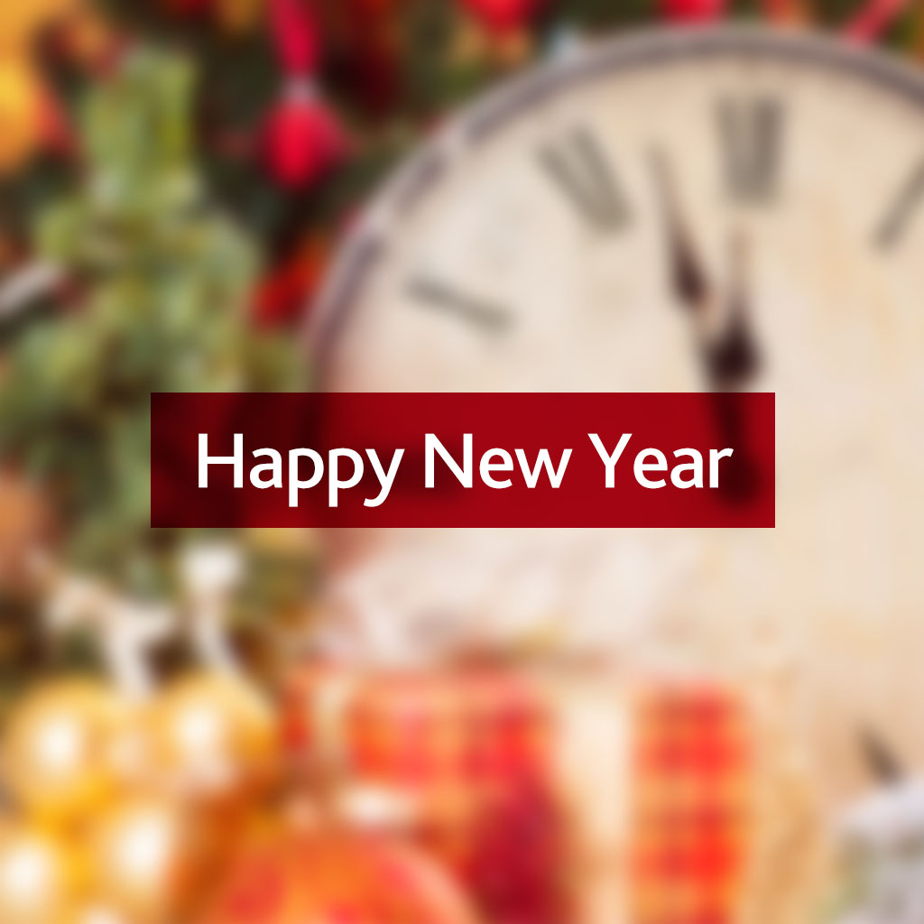 Happy New Year message on a blurred Christmas background with a clock